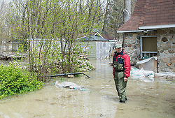 Attila Gabriel stands in his yard surrounded by floodwaters in the town of Rigaud, Quebec, Canada., west of Montreal, Monday, May 8, 2017, following flooding in the region. Photo by Graham Hughes /The Canadian Press/ABACAPRESS.COM