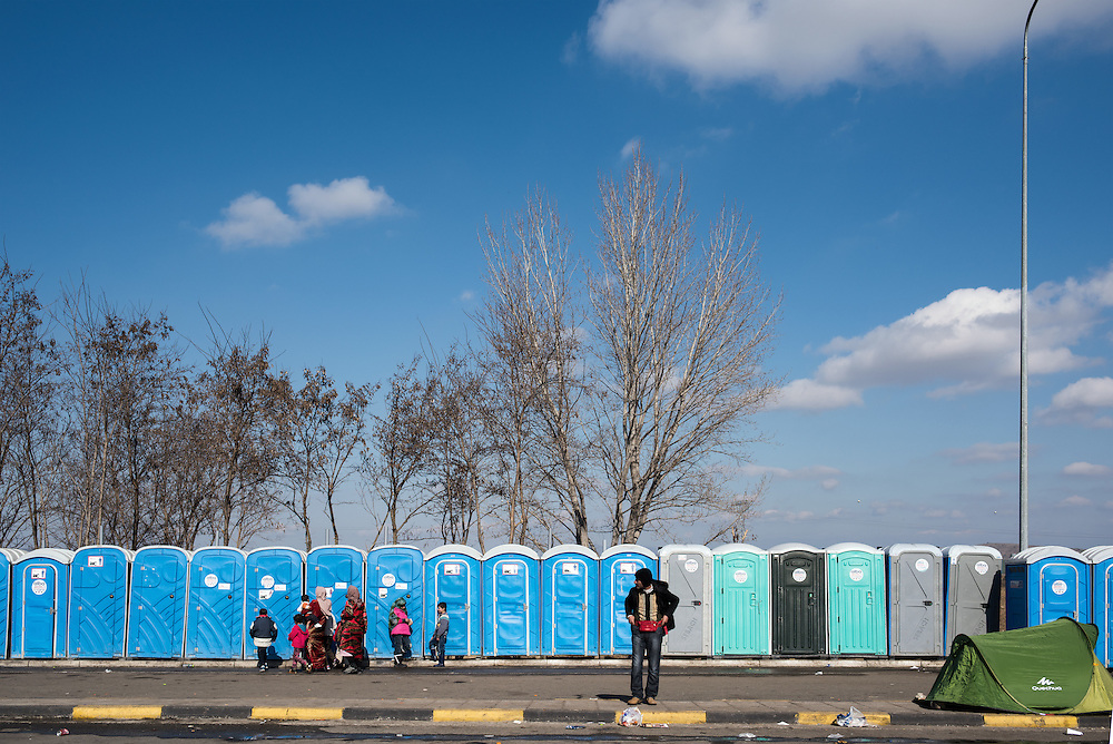 The portable toilets at the petrol station near Idomeni. In the last few months the fields near this petrol station have become a transit camp for thousands of refugees and migrants waiting to cross to Greek Macedonian border.