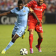 Kelechi Iheanacho, (left), Manchester City, is challenged by Emre Can , Liverpool, during the Manchester City Vs Liverpool FC Guinness International Champions Cup match at Yankee Stadium, The Bronx, New York, USA. 30th July 2014. Photo Tim Clayton