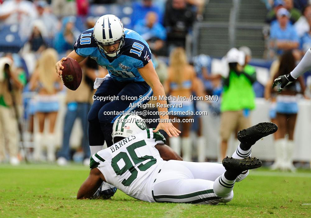 September 29, 2013 - Nashville, TN, U.S. - Tennessee Titans quarterback Jake Locker (10) is sacked by New York Jets linebacker Antwan Barnes (95) during 1st half action at LP Field in Nashville, Tn