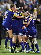 The Highlanders celebrate Kade Poki's try..Investec Super Rugby - Highlanders v Chiefs, 25 February 2011, Carisbrook Stadium, Dunedin, New Zealand..Photo: Rob Jefferies / www.photosport.co.nz/SPORTZPICS