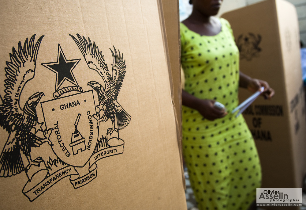 A woman exits a polling booth after filling her ballot during presidential and parliamentary elections in Accra, Ghana on Sunday December 7, 2008.