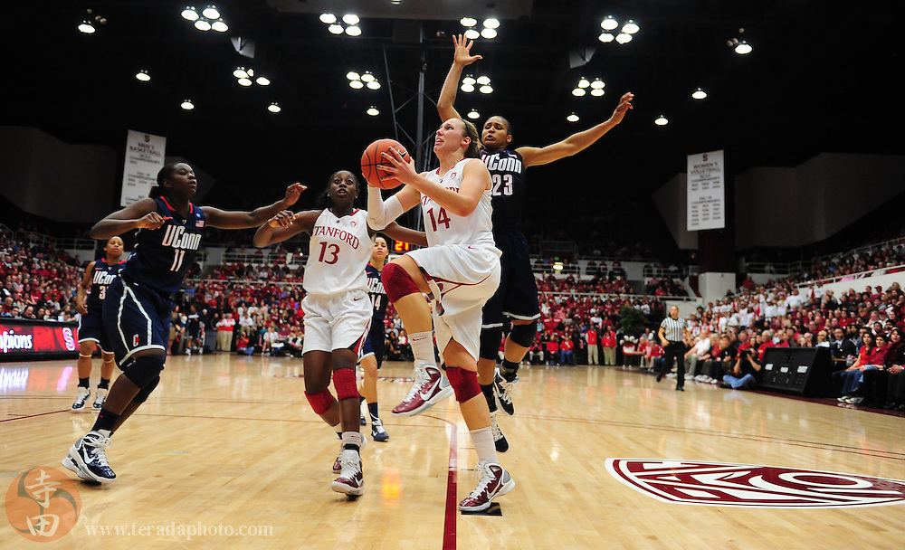 December 30, 2010; Stanford, CA, USA; Stanford Cardinal forward Kayla Pedersen (14) drives to the basket past Connecticut Huskies forward Maya Moore (23) during the second half at Maples Pavilion. The Cardinal defeated the Huskies 71-59. Mandatory Credit: Kyle Terada-Terada Photo