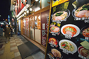 Dining at a ramen restaurant in Japan.