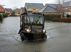 The only way to travel, an amphibious vehicle assists in the rescue and evacuation of local resident in Egham, Surrey, United Kingdom, Wednesday 12th February 2014. Picture by David Dyson / i-Images