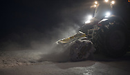 A Cruz Construction Inc. tractor makes ice chips on a lake on the North Slope for use on the Prudhoe Bay - Badami ice road on Januray 24, 2013. The road to Badami is part of a longer winter-only corridor to the Point Thompson field.