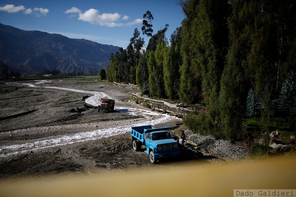 People wash their trucks with the same waters used for irrigation in the south of La Paz, Bolivia, Thursday, July 1, 2010.