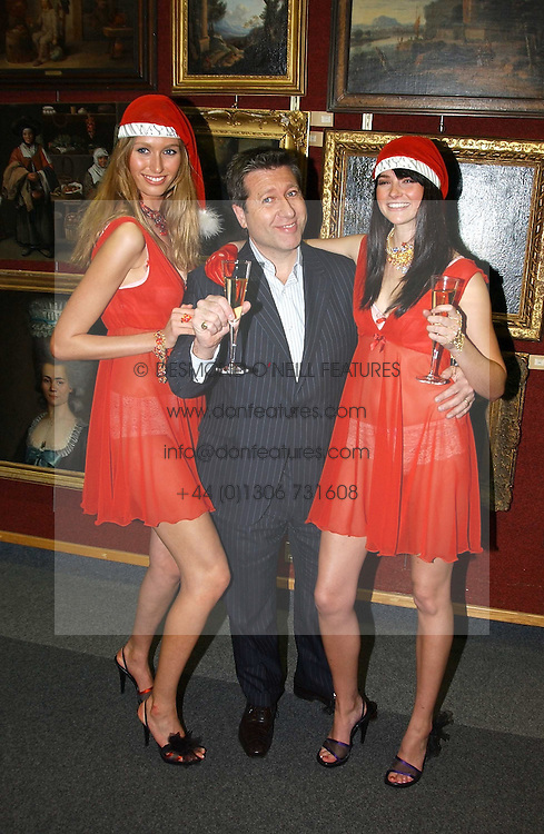 Left to right, model SARAH EL-HINI, DJ NEIL FOX and model GEORGINA PORCHETTA at the Macmillan Cancer Relief Celebrity Christmas Stocking Auction held at Christie's, South Kensington, London on 8th December 2004.<br /><br />NON EXCLUSIVE - WORLD RIGHTS