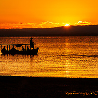 Fishermen working during the last moments of sunlight in Golfito, Costa Rica, 2011