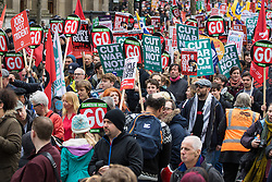 "London, April 16th 2016. Protesters placards and banner create a dense, colourful display as thousands of people supported by trade unions and other rights organisations demonstrate against the policies of the Tory government, including austerity and perceived favouring of ""the rich"" over ""the poor""."