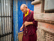 31 JULY 2015 - KATHMANDU, NEPAL: Buddhist monks visit the wreckage of a Buddhist monastery at Swayambhunath, also known as the Monkey Temple. Two monks were killed when the monastery was destroyed by the earthquake. Swayambhunath is a complex of Buddhist and Hindu temples in Kathmandu. It was heavily damaged in the Nepal Earthquake. The Nepal Earthquake on April 25, 2015, (also known as the Gorkha earthquake) killed more than 9,000 people and injured more than 23,000. It had a magnitude of 7.8. The epicenter was east of the district of Lamjung, and its hypocenter was at a depth of approximately 15km (9.3mi). It was the worst natural disaster to strike Nepal since the 1934 Nepal–Bihar earthquake. The earthquake triggered an avalanche on Mount Everest, killing at least 19. The earthquake also set off an avalanche in the Langtang valley, where 250 people were reported missing. Hundreds of thousands of people were made homeless with entire villages flattened across many districts of the country. Centuries-old buildings were destroyed at UNESCO World Heritage sites in the Kathmandu Valley, including some at the Kathmandu Durbar Square, the Patan Durbar Squar, the Bhaktapur Durbar Square, the Changu Narayan Temple and the Swayambhunath Stupa. Geophysicists and other experts had warned for decades that Nepal was vulnerable to a deadly earthquake, particularly because of its geology, urbanization, and architecture.        PHOTO BY JACK KURTZ
