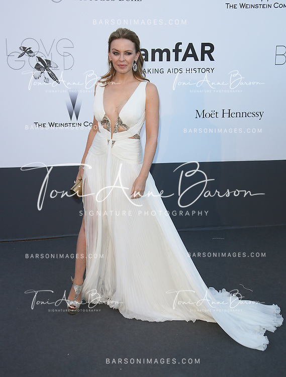 CAP D'ANTIBES, FRANCE - MAY 23:  Kylie Minogue arrives at amfAR's 20th Annual Cinema Against AIDS at Hotel du Cap-Eden-Roc on May 23, 2013 in Cap d'Antibes, France.  (Photo by Tony Barson/FilmMagic,)