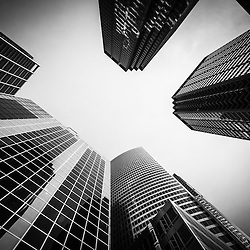 Photo of Chicago buildings in black and white with skyscrapers looking upward toward the sky.