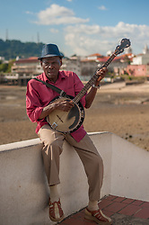 "Not all images tell the whole truth. Although this dapper dude singing ""Day-o"" with his banjo appears to be a talented busker, he was no Harry Belafonte, Jr. Instead, he simply sang the same line over and over and over. But it was ok, he nailed the part physically and certainly brightened up the neighborhood."