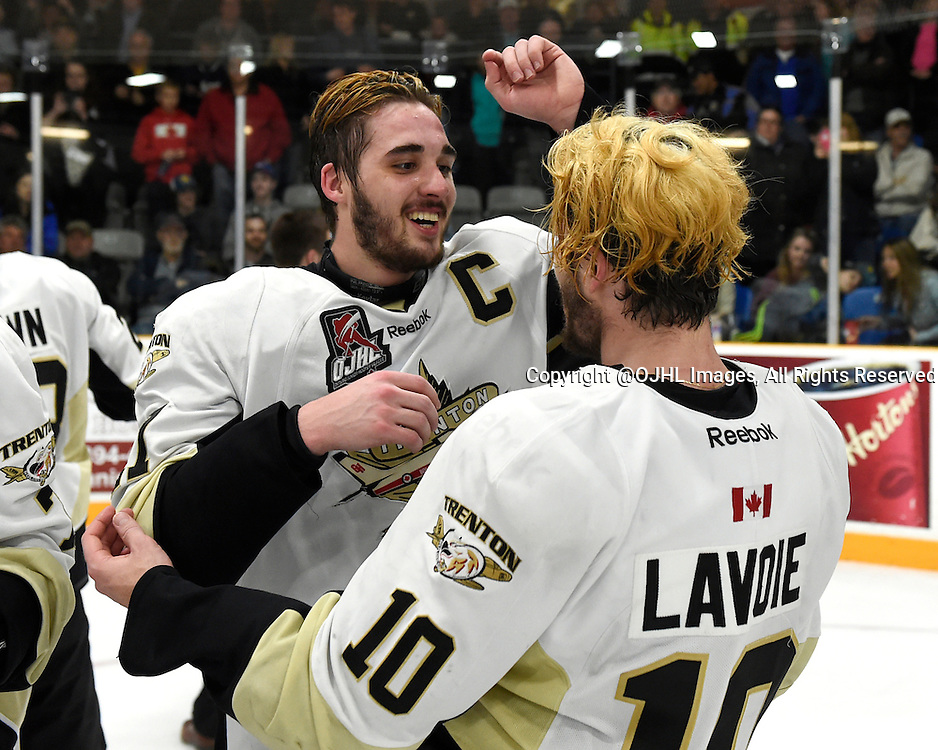 TRENTON, ON - Apr 22, 2016 -  Ontario Junior Hockey League game action between the against the Trenton Golden Hawks and the Georgetown Raiders. Game 5 of the Buckland Cup Championship Series, at the Duncan Memorial Gardens in Trenton, Ontario. Danny Hanlon #27 and Kevin Lavoie #10 of the Trenton Golden Hawks celebrate winning the 2015-2016  Buckland Cup.<br /> (Photo by Andy Corneau / OJHL Images)