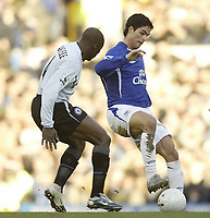 Photo: Aidan Ellis.<br /> Everton v Chelsea. The FA Cup. 28/01/2006.<br /> Everton's Mikkael Arteta holds off Chelsea's Claude Makellle