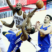09 June 2017:  Golden State Warriors forward Kevin Durant (35) goes for the acrobatic shot against Cleveland Cavaliers center Tristan Thompson (13) during the Cleveland Cavaliers 137-11 victory over the Golden State Warriors, in game 4 of the 2017 NBA Finals, at  the Quicken Loans Arena, Cleveland, Ohio, USA.