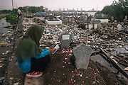April 28, 2016. CENTRALJAVA-INDONESIA.  <br /> <br /> Every Thursday afternoon, pilgrims go to the cemetery to praying for their family, and passing the only one of broken road because of the abrasion on the side of the coast of the Tambak Lorok Village in Semarang City, Central Java, Indonesia.<br /> Abrasion struck the Tambak Lorok coastal village, Sub-district of Tanjungmas, District North of Semarang, more severe because the land has eroded over 1 kilometer from the shoreline. As a result of this coastal damage caused tidal water entered into the home of locals with a height of between 60 cm to 1 meter, including damaging the cemetery lands on the side of the village. There are at least 22 heads of families in the area were forced to evacuate to a safer place. According to some residents of the Tambak Lorok Village, if not addressed seriously by the government, they believe within one to two years ahead more damage will be even worse than today.<br /> &copy; Aji Styawan/ Exclusivepix Media