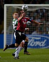 Photo: Jed Wee.<br /> Glasgow Celtic v FC Copenhagen. UEFA Champions League, Group F. 26/09/2006.<br /> <br /> Copenhagen's Tobias Linderoth (R) beats Celtic's Neil Lennon to the ball.