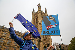 © Licensed to London News Pictures. 07/01/2019. London, UK. Anti-Brexit and Pro-Brexit demonstrators protest outside the Houses of Parliament as MPs will vote on British Prime Minister, Theresa May's withdrawal agreement with the EU on Tuesday, 15 January according to the UK Government. Photo credit: Dinendra Haria/LNP