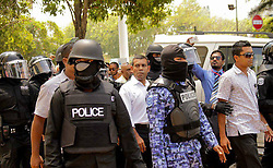 Former Maldivian President Mohammed Nasheed (C) is arrested by policemen in Male, capital of Maldives, on March 5, 2013. Mohammed Nasheed was arrested by the Maldivian police on Tuesday, causing fresh uproar and protests in the capital Male, officials said,  March 5, 2013. Photo by Imago / i-Images...UK ONLY