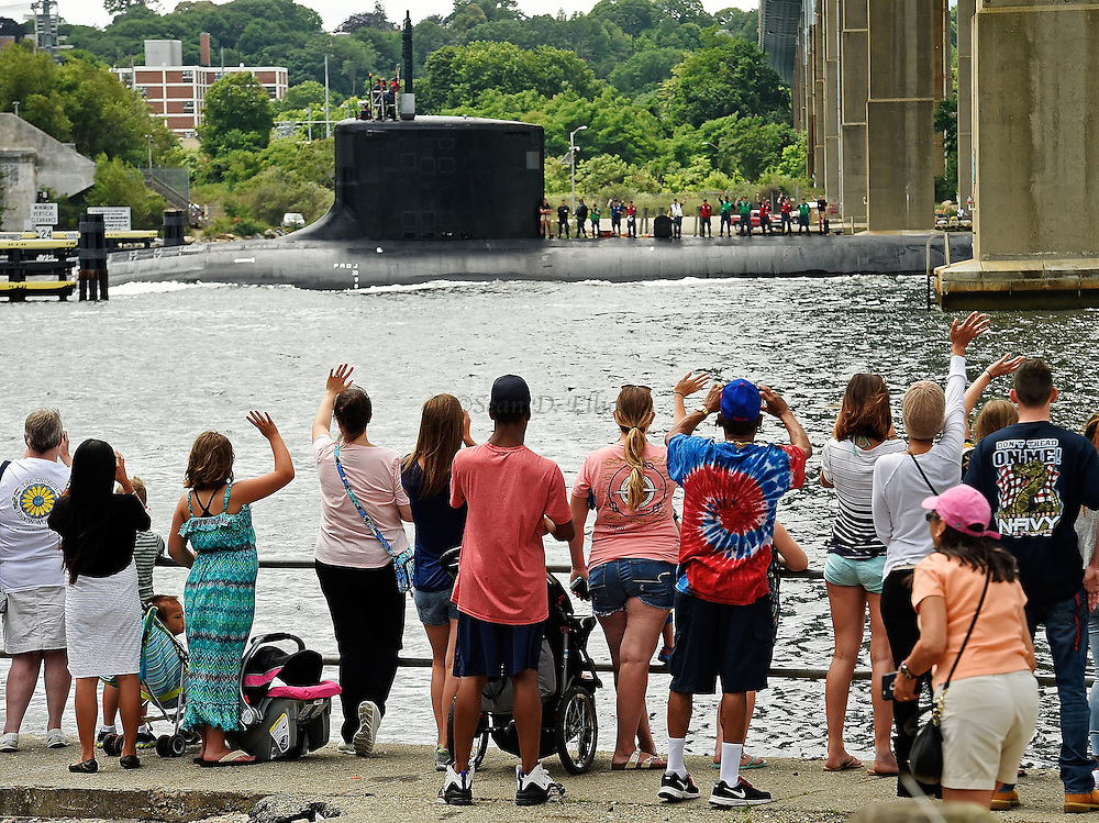 7/5/16 :: REGION :: STAND ALONE :: Family members wave to the U.S. Navy Virginia-class attack submarine USS Minnesota (SSN 783) from the state boat launch under the Gold Star Memorial Bridge in Groton, Conn., Tuesday, July 5, 2016. The Minnesota, the tenth boat in the Virginia-class, was commissioned in September of 2013 but spent more than two years undergoing repairs to faulty welds and was just returned to the Navy submarine base in Groton at the end of May. (Sean D. Elliot/The Day)