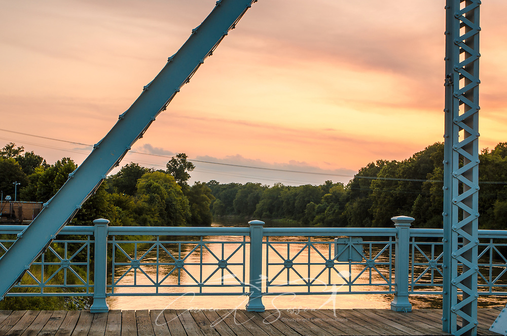 The sun sets over the Yazoo River at the Keesler Bridge in Greenwood, Miss. The bridge was built in 1925.  (Photo by Carmen K. Sisson/Cloudybright)