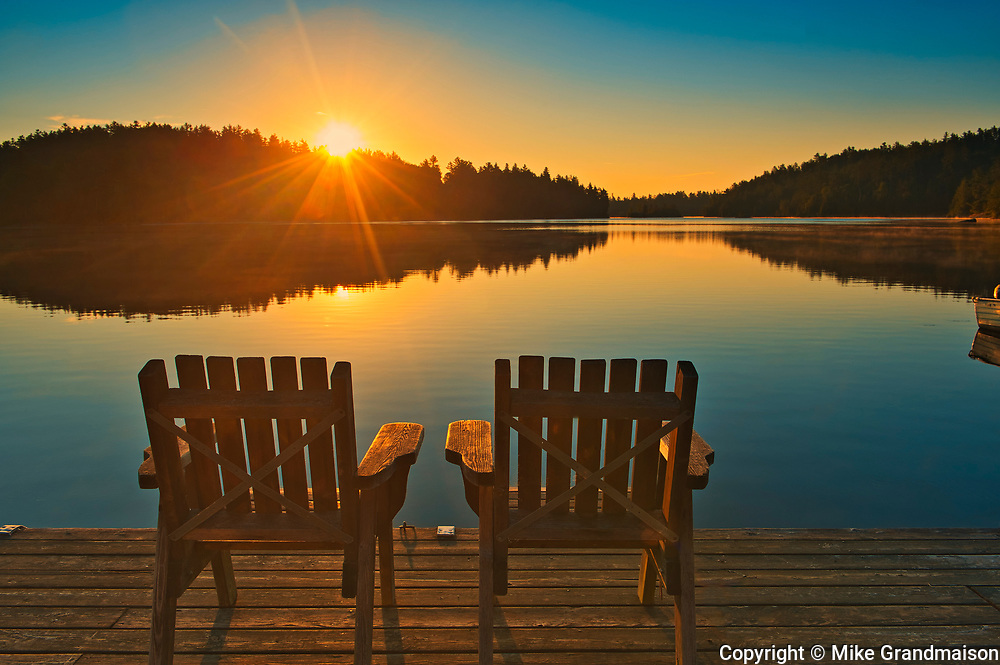 Muskoka chairs on Snake Island Lake (Cassels Lake) at sunrise<br />