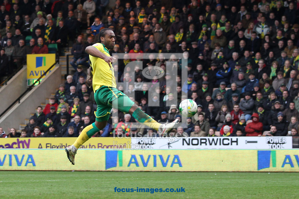 Cameron Jerome of Norwich in action during the Sky Bet Championship match at Carrow Road, Norwich<br /> Picture by Paul Chesterton/Focus Images Ltd +44 7904 640267<br /> 21/03/2015
