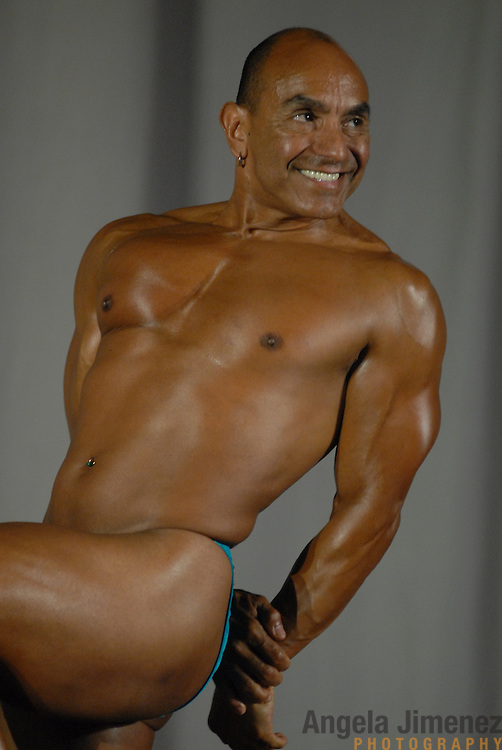 Armando Luna, of San Francisco, California, poses during the Physique (bodybuilding) competition 40-49 year old age group lightweight division at McGaw Memorial Hall/Welsh-Ryan Arena at Northwestern University in Evanston, Illinois during the Gay Games VII competition on July 19, 2006. <br /> <br /> <br /> Luna finished fourth in the standard category in his division. <br /> <br /> Over 12,000 gay and lesbian athletes from 60 countries are in Chicago competing in 30 sports during the Games from July 15 through 22, 2006. <br /> <br /> Over 50,000 athletes have competed in the quadrennial Games since they were founded by Dr. Tom Wadell, a 1968 Olympic decathlete, and a group of friends in San Francisco in 1982, with the goal of using athletics to promote community building and social change. <br /> <br /> The Gay Games resemble the Olympics in structure, but the spirit is one of inclusion, rather than exclusivity. There are no qualifying events or minimum or maximum requirements.<br /> <br /> The Games have been held in Vancouver (1990), New York (1994), Amsterdam (1998), and Sydney (2002).