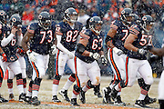 The Chicago Bears offense breaks the huddle and heads to the line as a group during the NFL 2011 NFC Divisional playoff football game against the Seattle Seahawks on Sunday, January 16, 2011 in Chicago, Illinois. The Bears won the game 35-24. ©Paul Anthony Spinelli