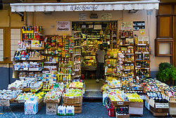 Sorrento, Italy, September 15 2017. A grocer selling traditional products and souvenirs awaits customers in the early morning in Sorrento, Italy. © Paul Davey