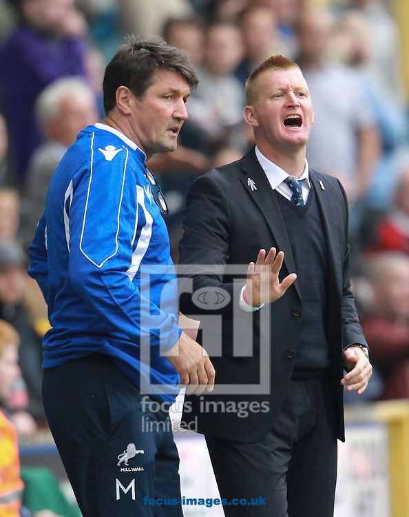 Picture by John Rainford/Focus Images Ltd +44 7506 538356<br /> 28/09/2013<br /> Steve Lomas, manager of Millwall with his assistant Mick Harford during the Sky Bet Championship match at The Den, London.