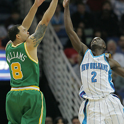 Feb 17, 2010; New Orleans, LA, USA; Utah Jazz guard Deron Williams (8) shoots over New Orleans Hornets guard Darren Collison (2) during the second quarter at the New Orleans Arena. Mandatory Credit: Derick E. Hingle-US PRESSWIRE