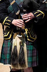 View of traditional Scottish piper in tartan playing for tourists on the Royal Mile in Edinburgh, Scotland, UK