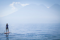 Lake Atitlan, Guatemala.  Paddle boarder on Lake Atitlan.