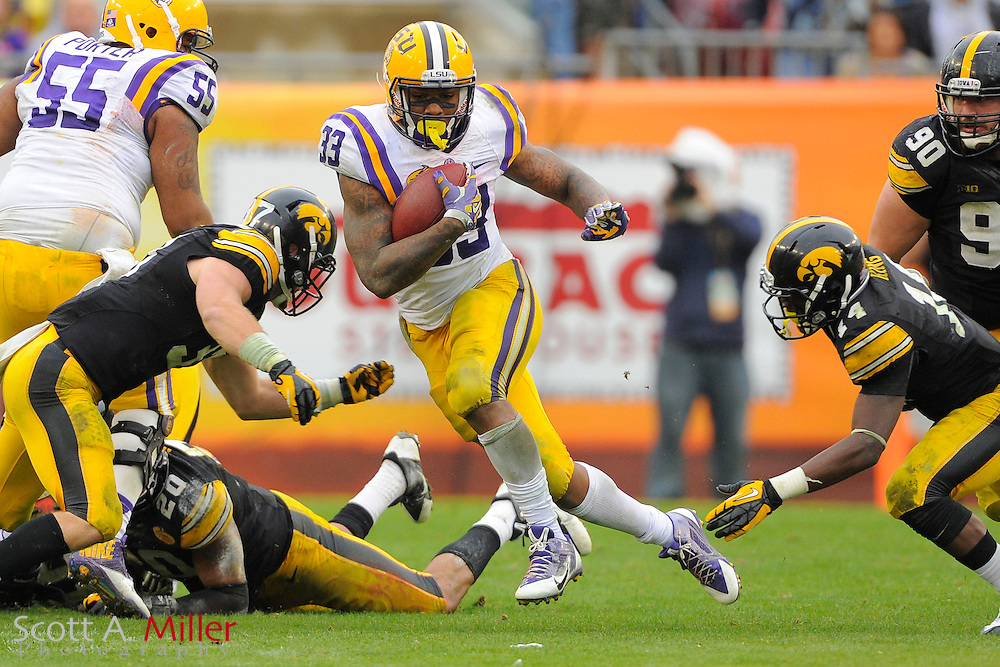 LSU Tigers running back Jeremy Hill (33) runs with the ball during LSU's 21-14 win over the Iowa Hawkeyes in the 2014 Outback Bowl at Raymond James Stadium on Jan 1, 2014  in Tampa, Florida.            ©2014 Scott A. Miller