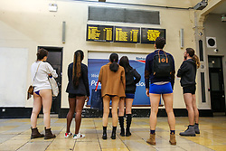 "© Licensed to London News Pictures. 13/01/2019. London, UK. Participants take part in 10th anniversary of 'No Trousers Tube Ride' by viewing the information board at Paddington Station. The ""No Pants Subway Ride"" is an annual event staged by Improve Everywhere every January in New York City. The mission started as a small prank with seven guys and has grown into an international celebration of silliness, with dozens of cities including London around the world participating each year. Photo credit: Dinendra Haria/LNP"