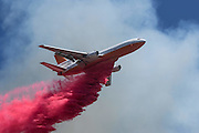 August 16, 2016 - San Bernardino, California, U.S - An air taker drops fire retardant on the Blue Cut Fire near Lytle Creek Road in Lytle Creek Wednesday. The Blue Cut fire has destroyed an unknown number of homes. More than 1,300 firefighters and other emergency workers are battling the Blue Cut fire, which started early Tuesday 60 miles east of Los Angeles. <br /> ©Exclusivepix Media