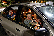 """The Hartzells are a family in crisis. At the end of the month, when money's tight. The family of four sleeps in their car, moving around to different big box store parking lots so they don't get discovered. Well hidden, at a choice spot, toward the back of the parking lot with bushes on one side of the car, mom Ronale Hartzell, in the passenger seat, and the kids Brent, 18, and Danielle, 14, in the back, keep an eye out for anyone that might ask them to leave, like police and store employees tracking down shopping carts, while dad, Danny Hartzell ran into the store to use the restroom. """"We don't sleep much,"""" said Ronale, who hears every noise, and complains that the bright lights in the parking lot and the stifling heat keep her awake."""