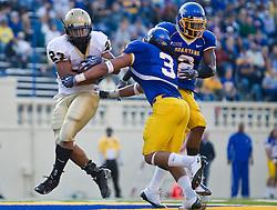 October 10, 2009; San Jose, CA, USA;  Idaho Vandals running back DeMaundray Woolridge (23) scores a touchdown past San Jose State Spartans linebacker Pompey Festejo (3) and safety Duke Ihenacho (2)during the second quarter at Spartan Stadium.  Idaho won 29-25.