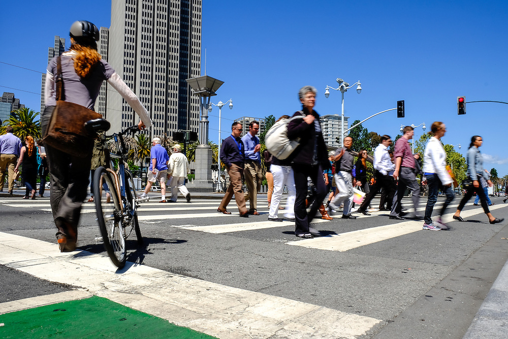 Pedestrians cross the street on their way to San Francisco's Ferry building | May 6, 2014