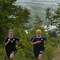 St Johnstone players back in pre-season training today, doing some tough hill running above Perth, pictured new player coach Mixu Paatelainen with Ryan Stevenson<br />see story by Gordon Bannerman Tel: 07729 865788<br />Picture by Graeme Hart.<br />Copyright Perthshire Picture Agency<br />Tel: 01738 623350  Mobile: 07990 594431