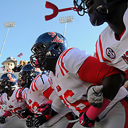 Mississippi players prepare to take the field before an NCAA college football game against Arkansas in Little Rock, Ark., Saturday, Oct. 27, 2012. (Photo/Thomas Graning)