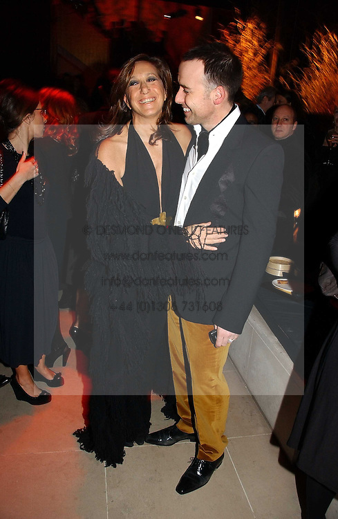 DONNA KARAN and DAVID FURNISH at the launch party for Donna Karan's new fragrance Gold held at the Donna Karan store, 19 New Bond Street, London on 16th November 2006.<br />