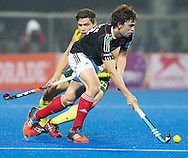 BHUBANESWAR (India) -  Hero Champions Trophy hockey men. Semifinal Germany vs Australia. Tobias Hauke of Germany with Flynn Ogilvie. Photo Koen Suyk