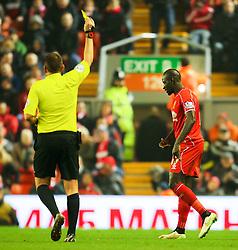 Liverpool's Mamadou Sakho receives a yellow card - Photo mandatory by-line: Matt McNulty/JMP - Mobile: 07966 386802 - 10/02/2015 - SPORT - Football - Liverpool - Anfield - Liverpool v Tottenham Hotspur - Barclays Premier League