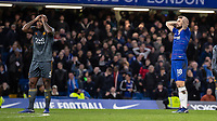 Football - 2018 / 2019 Premier League - Chelsea vs. Leicester City<br /> <br /> Players of both sides Wes Morgan (Leicester City) and Oliver Giroud (Chelsea FC)  hold their head in their hands as Chelsea hit the post in the dying minutes at Stamford Bridge <br /> <br /> COLORSPORT/DANIEL BEARHAM