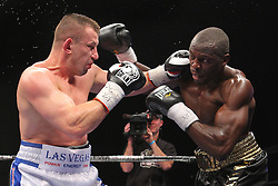 Dec 22, 2012; New York, NY, USA; Tomasz Adamek (White/Blue trunks) and Steve Cunningham (Black/Gold trunks) during their 12 round IBF North American Heavyweight title bout at the Sands Casino Resort Bethlehem.
