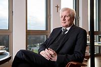 10 DEC 2016, BERLIN/GERMANY:<br /> Horst Seehofer, CSU, Bundesinnenminister, waehrend einem Interview, in seinem Buero, Bundesinnenministerium<br /> IMAGE: 20181210-02-044<br /> KEYWORDS; Büro, Kreuz